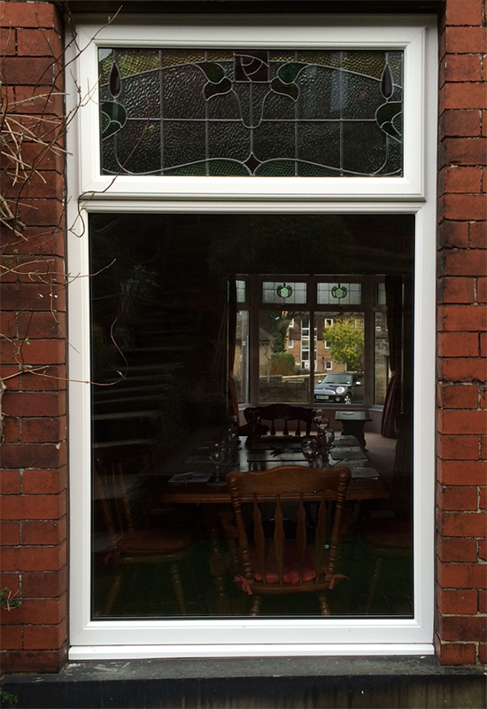 A close up photo showing the detail of the newly installed encapsulated stained UPVC window.