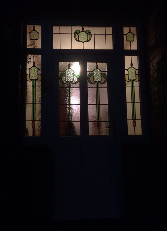 Encapsulated Stained UPVC At Night - Huddersfield