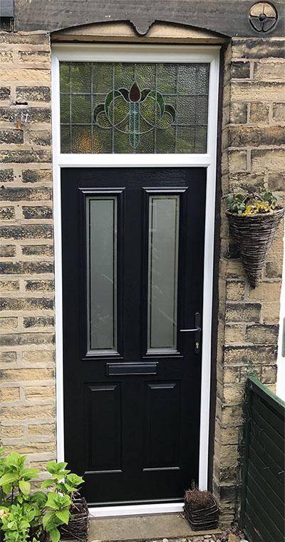 Composite Door With Encapsulated Fanlight Window
